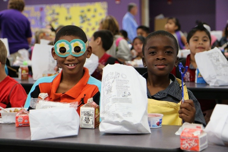 Two Richey Elementary students enjoying breakfast and their egg bags!