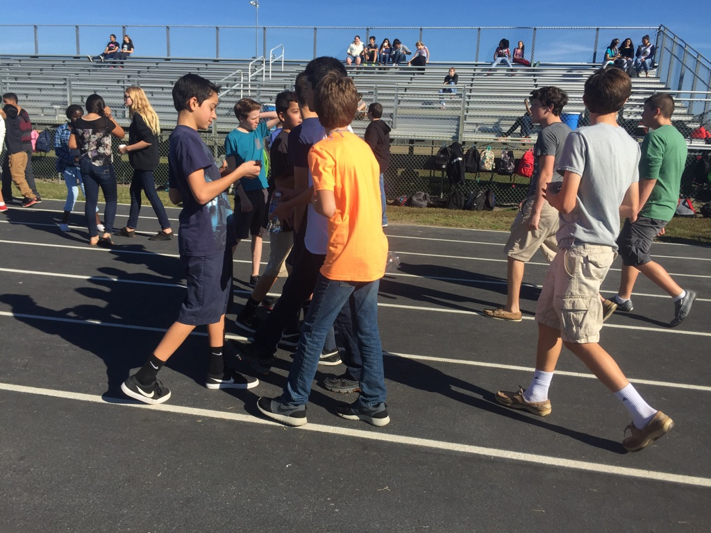 Students walk around the track completing laps for their walk-a-thon fundraiser.